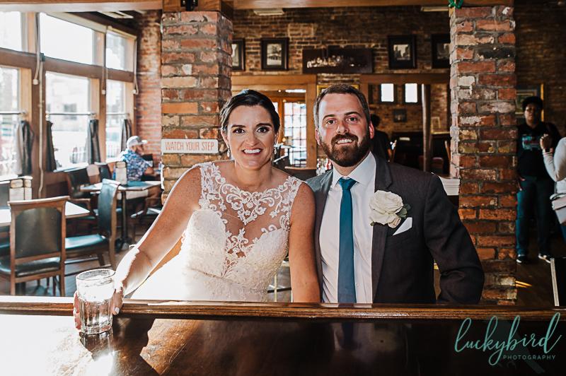 bride-and-groom-wedding-photo-at-mantahhans-downtown-toledo-bar
