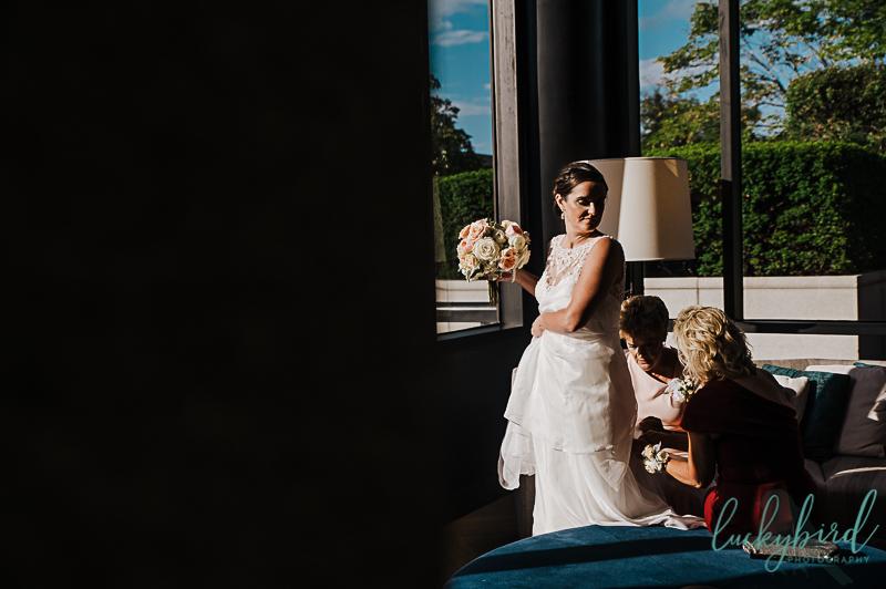 bride-getting-bustled-at-renaissance-toledo-wedding