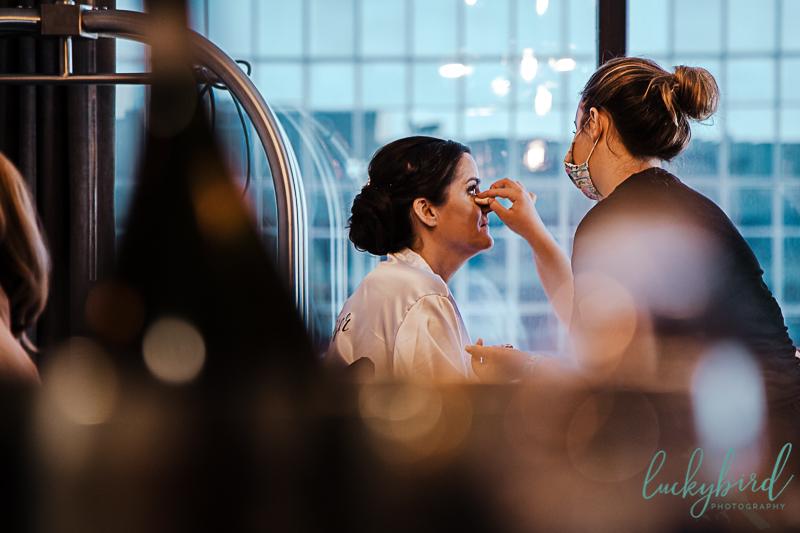 bride-getting-makeup-done-at-renaissance-toledo