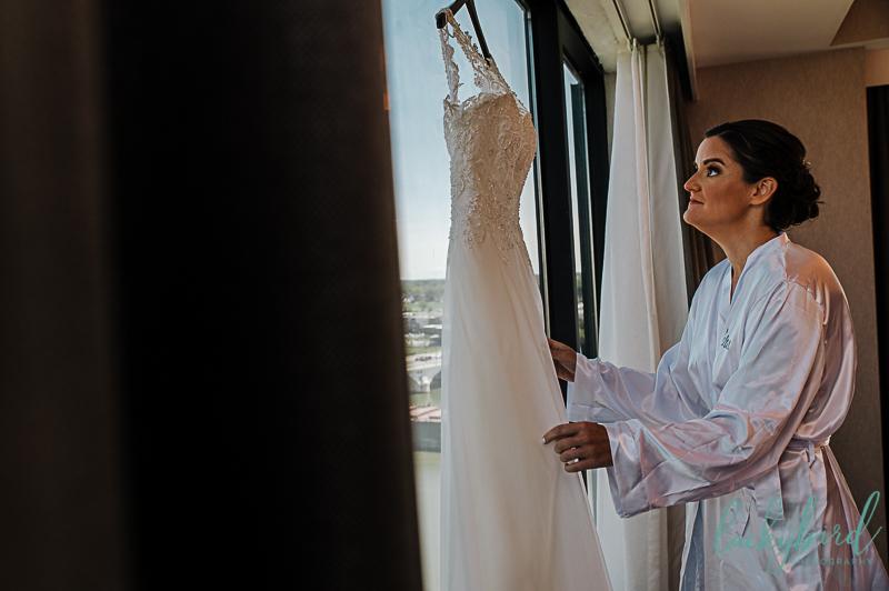 bride-looking-at-wedding-dress-at-renaissance-toledo