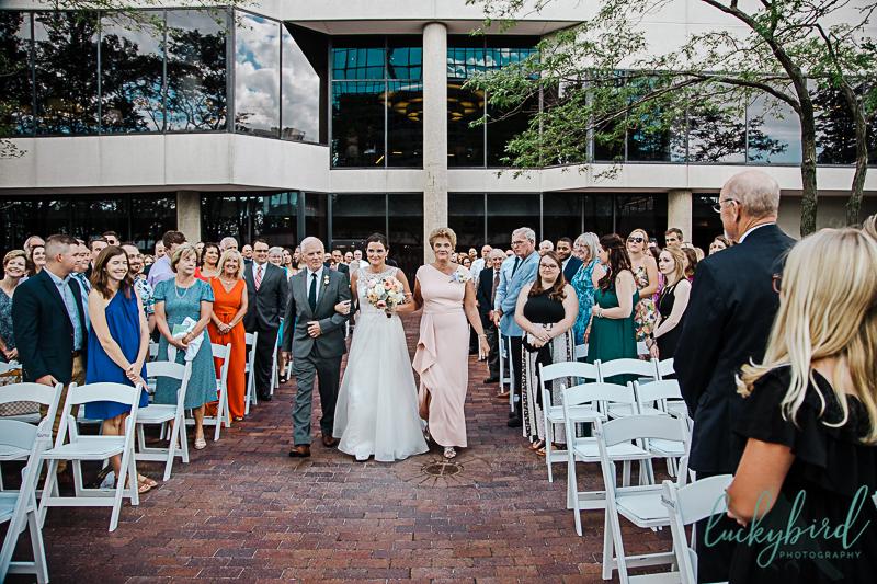 bride-walking-with-parents-for-renaissance-toledo-wedding