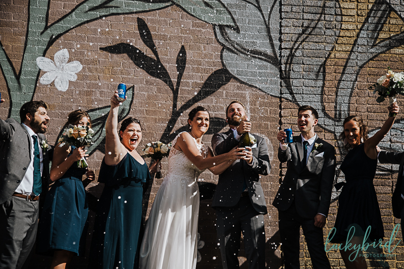 downtown-toledo-wedding-photo-with-champagne