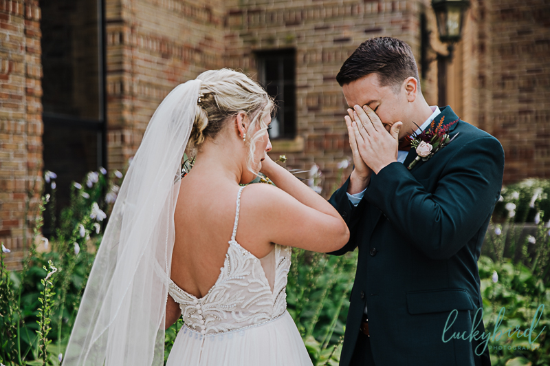 groom-crying-during-nazareth-hall-first-look