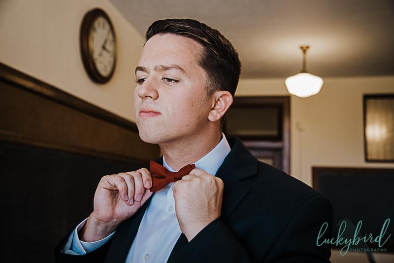 groom-putting-on-his-tie