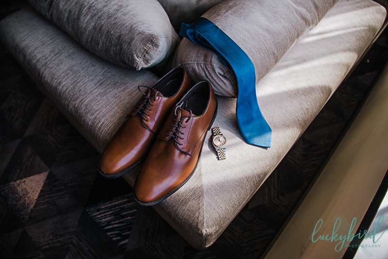 grooms-shoes-and-watch-and-tie-at-renaissance-toledo-hotel