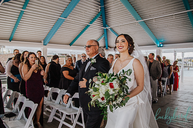 bride-and-dad-walking-down-the-aisle-for-roostertail-wedding-ceremony