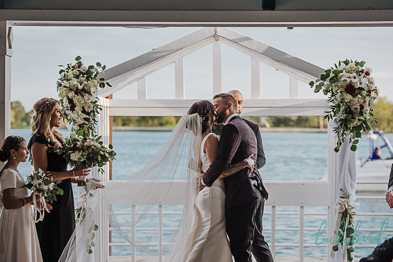 first-kiss-after-roostertail-wedding-ceremony