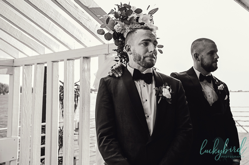 groom-seeing-bride-walk-down-the-aisle-for-roostertail-wedding-ceremony